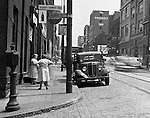 Pittsburgh PA:  View of Forbes Avenues and Hooper Street in the uptown section of Pittsburgh near Duquesne University - 1950.  Assignment was for a developer trying to get some of the buildings condemned so he could get them at a good price for future development.