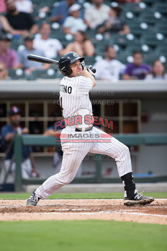 Vinny Rottino (4) of the Charlotte Knights follows through on his swing against the Pawtucket Red Sox at BB&T BallPark on July 6, 2016 in Charlotte, North Carolina.  The Knights defeated the Red Sox 8-6.  (Brian Westerholt/Four Seam Images)