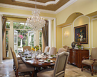 Luxurious dining room with Waterford Crystal chandelier and wall sconces