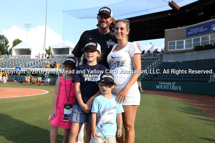 04 June 2016: Nova Southeastern head coach Greg Brown with his family, <br /> <br />  The Nova Southeastern University Sharks played the Millersville University Marauders in Game 14 of the 2016 NCAA Division II College World Series  at Coleman Field at the USA Baseball National Training Complex in Cary, North Carolina. Nova Southeastern won the game 8-6 and clinched the NCAA Division II Baseball Championship.