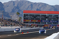 Feb 25, 2017; Chandler, AZ, USA; NHRA pro stock driver Allen Johnson (left) races alongside Alan Prusiensky during qualifying for the Arizona Nationals at Wild Horse Pass Motorsports Park. Mandatory Credit: Mark J. Rebilas-USA TODAY Sports