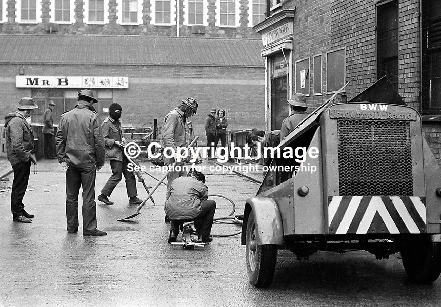Members of the Ulster Defence Association (UDA) start to erect a permanent barricade in the Woodvale district of Belfast  with the benefit of pneumatic drills and a portable generator/compressor. NI Troubles. Masked men. Ref: 19720630002...Copyright Image from Victor Patterson, 54 Dorchester Park, Belfast, UK, BT9 6RJ..Tel: +44 28 9066 1296.Mob: +44 7802 353836.Voicemail +44 20 8816 7153.Skype: victorpattersonbelfast.Email: victorpatterson@mac.com.Email: victorpatterson@ireland.com (back-up)..IMPORTANT: If you wish to use this image or any other of my images please go to www.victorpatterson.com and click on the Terms & Conditions. Then contact me by email or phone with the reference number(s) of the image(s) concerned.