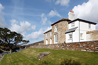 Several buildings on this property, including the main house overlooking the estuary, have been restored using local materials