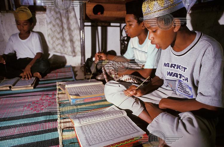 Children reciting the Koran.