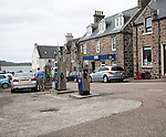 Petrol pumps and shop in the main shopping street in Castlebay the largest settlement in Barra, Outer Hebrides, Scotland, UK