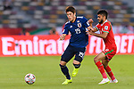 Sakai Hiroki of Japan (L) competes for the ball with Salaah Al Yahyaei of Oman (R) during the AFC Asian Cup UAE 2019 Group F match between Oman (OMA) and Japan (JPN) at Zayed Sports City Stadium on 13 January 2019 in Abu Dhabi, United Arab Emirates. Photo by Marcio Rodrigo Machado / Power Sport Images