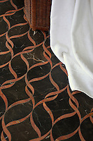 Sophie, a natural stone waterjet mosaic shown in polished Red Travertine and Saint Laurent, is part of the Silk Road Collection by Sara Baldwin for New Ravenna Mosaics.<br />