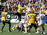 Jeremy Ross of California leaps over UCLA defenders during punt return against UCLA at Memorial Stadium in Berkeley, California on October 9th, 2010.   California defeated UCLA, 35-7.