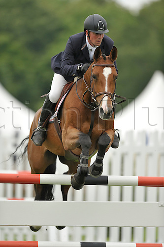 21.06.2012 The All England Jumping Course  Hickstead, England.  Belinka vh Overlede Goed ridden by Guy Williams [GBR] in action during The Stoner Jewellers Vase at The British Jumping Derby Meeting. Guy went on to finish in second place in a time of 78.54 seconds.