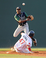 June 19, 2009: Second baseman Albert Cartwright (3) of the Lexington Legends turns the first half of a double play by erasing the Greenville Drive's Kade Keowen (47) in a game at Fluor Field at the West End in Greenville, S.C. Photo by: Tom Priddy/Four Seam Images
