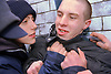 Teenage young offenders fighting in the street,