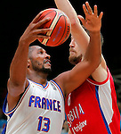France's Boris Diaw (L) vies with Serbia's Ognjen Kuzmic (R) during European championship basketball match for third place between France and Serbia on September 20, 2015 in Lille, France  (credit image & photo: Pedja Milosavljevic / STARSPORT)
