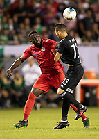 CHICAGO, IL - JULY 7: Jozy Altidore #17 and Hector Moreno #15 go for the ball during a game between Mexico and USMNT at Soldiers Field on July 7, 2019 in Chicago, Illinois.