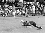 "A young girl does the splits during a parade before annual ""Logging Festival"" in Priest River, Idaho in July of 2009."