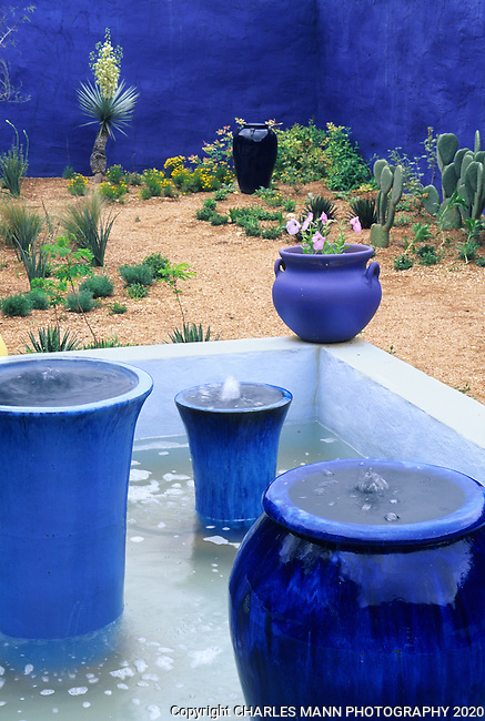 At the Antique Rose Emporium in San Antonio, Mike Shoup took ceramic pots of different shade of blue and created a fountain that echos the blue walls of his garden which he modeled from the Moroccan garden Majorelle.