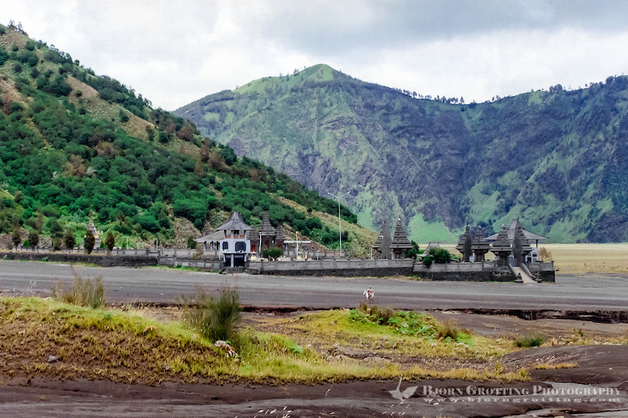 Java, East Java, Mount Bromo. On the Segara Wedi sand plain sits a Hindu temple called Pura Luhur Poten.