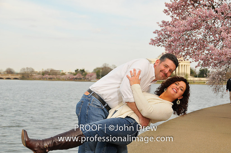 Lifestyle Engagement Photo Session with the Cherry Blossoms on The Tidal Basin of the National Mall, Washington DC.  Photography by John Drew c/o Professional Image Image.