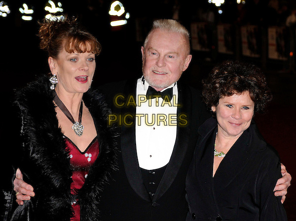 "SAMANTHA BOND, DEREK JACOBI & IMELDA STAUNTON.World Premiere of ""Bunch of Amateurs"" at the Odeon, Leicester Square London, England. .November 17th 2008.half length black coat jacket bow tie red lipstick silver black necklace earrings fur collar fringe hair up do beard facial hair .CAP/CAN.©Can Nguyen/Capital Pictures."