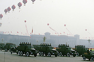Beijing, China. October 1st, 1984. This huge parade is for the celebration of the 35th Anniversary of the Chinese Revolution. China is well known for its mechanic forces.