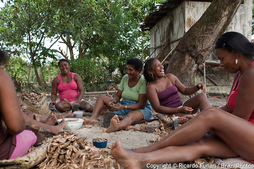 Black women break babaçu coconuts for making oil at Agrovila Marudá, a Quilombo in Alcântara, Maranhão, Northeast Brazil. A quilombo is a Brazilian hinterland settlement founded by people of African origin. Most of the inhabitants of quilombos were escaped former slaves and, in some cases, a minority of marginalised non-slave Brazilians that faced oppression during colonization.