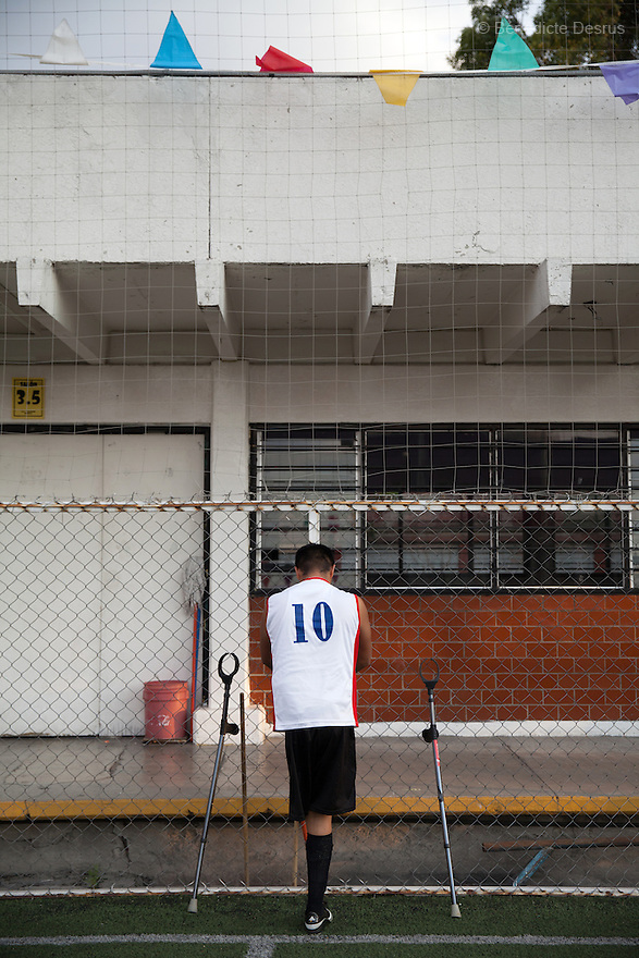 """Victor Hugo Bonilla Gonzalez, 32, a player from Guerreros Aztecas, portrayed during a training in Mexico City, Mexico on June 12, 2014. Victor lost his left leg after an assault in 2011. He is currently unemployed and he wants to be a DJ. Guerreros Aztecas (""""Aztec Warriors"""") is Mexico City's first amputee football team. Founded in July 2013 by five volunteers, they now have 23 players, seven of them have made the national team's shortlist to represent Mexico at this year's Amputee Soccer World Cup in Sinaloathis December.The team trains twice a week for weekend games with other teams. No prostheses are used, so field players missing a lower extremity can only play using crutches. Those missing an upper extremity play as goalkeepers. The teams play six per side with unlimited substitutions. Each half lasts 25 minutes. The causes of the amputations range from accidents to medical interventions – none of which have stopped the Guerreros Aztecas from continuing to play. The players' age, backgrounds and professions cover the full sweep of Mexican society, and they are united by the will to keep their heads held high in a country where discrimination against the disabled remains widespread.(Photo byBénédicte Desrus)"""