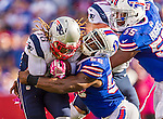 12 October 2014: New England Patriots running back Brandon Bolden (38) is tackled by Buffalo Bills outside linebacker Keith Rivers (56) at Ralph Wilson Stadium in Orchard Park, NY. The Patriots defeated the Bills 37-22 to move into first place in the AFC Eastern Division. Mandatory Credit: Ed Wolfstein Photo *** RAW (NEF) Image File Available ***