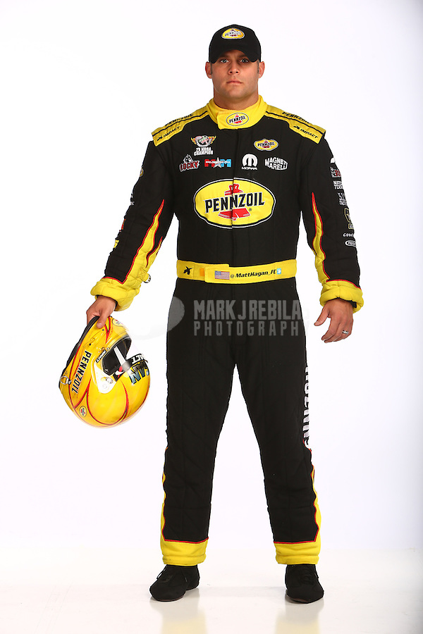 Jan 15, 2016; Brownsburg, IN, USA; NHRA funny car driver Matt Hagan poses for a portrait during a photo shoot at Don Schumacher Racing. Mandatory Credit: Mark J. Rebilas-USA TODAY Sports