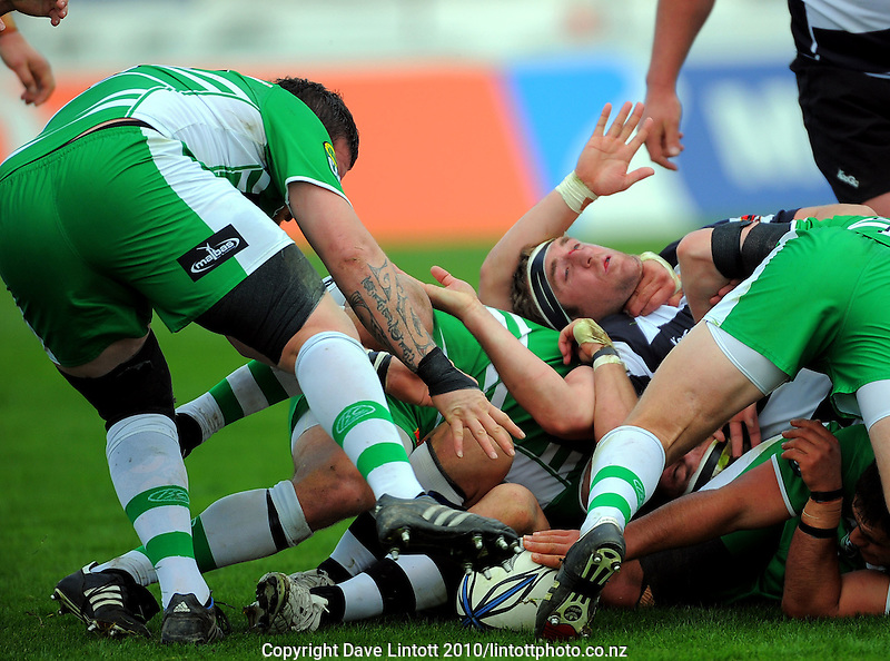 Manawatu prop Josh Keys reaches for ruck ball as Hawkes Bay number eight Michael Coman is held out of the way. ITM Cup rugby - Manawatu Turbos v Hawkes Bay at FMG Stadium, Palmerston North, New Zealand on Sunday, 29 August 2010. Photo: Dave Lintott/lintottphoto.co.nz