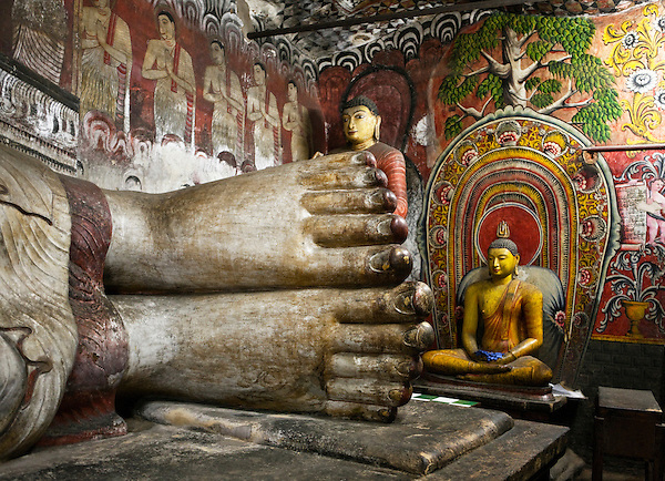 Buddha statues in cave temple, Dambulla, Sri Lanka.The city of Dambulla is situated in the Central Province of Sri Lanka, 148 km north-east of Colombo. The city is home to the largest and best preserved cave temple complex in Sri Lanka. A sacred pilgrimage site for 22 centuries, this cave monastery contains five sanctuaries and Buddhist mural paintings covering an area of 2,100 square meters.
