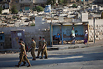 Israeli soldiers and settlers in a street of the Jewish Avraham Avinu settlement located in the Old City of Hebron. <br /> Hebron is a West Bank city that belongs to the Palestinian National Authority, about 400 Jewish settlers remain in some streets of the old town protected by some 2,000 Israeli soldiers.