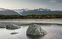 Southern Alps with Mt. Cook (right 3724m) and Mt. Tasman (left 3497m) viewed from Five Mile Lagoon at sunrise, Franz Josef Glacier on left, Westland Tai Poutini National Park, West Coast, UNESCO World Heritage Area, New Zealand, NZ