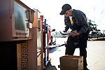 Newt Wallace, 93, stocks a Winters Express newspaper box February 6, 2013 in Winters, California. Wallace is believed to be the world's oldest paper delivery boy.