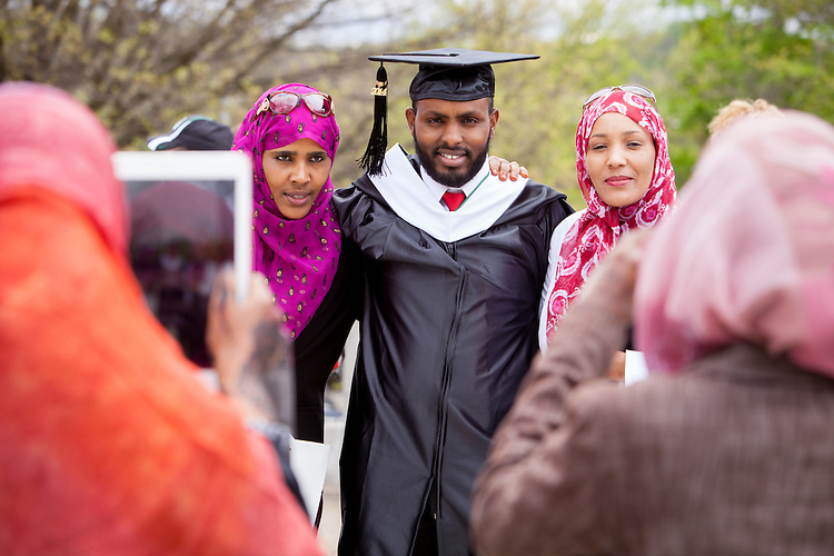 Mohamed Hashi of Somali poses for a photograph at the conclusion of the Commencement Ceremony at Ohio Univeristy Friday May 2, 2014.  Photo by Ohio University / Jonathan Adams