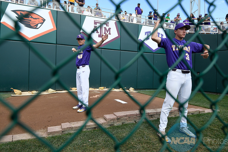 OMAHA, NE - JUNE 26: Louisiana State University players warm up before they take on the University of Florida during the Division I Men's Baseball Championship held at TD Ameritrade Park on June 26, 2017 in Omaha, Nebraska. The University of Florida defeated Louisiana State University 4-3 in game one of the best of three series. (Photo by Jamie Schwaberow/NCAA Photos via Getty Images)
