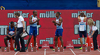 Adam GEMILI of GBR shows his disappointment after a Red Card as fellow Brits James DASAOLU (left) & Chijindu UJAH applaud him during the Muller Grand Prix Birmingham Athletics at Alexandra Stadium, Birmingham, England on 20 August 2017. Photo by Andy Rowland.
