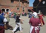 People maypole dancing during Tudor history re-enactment day, Layer Marney Tower, Essex, England