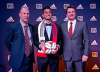 #13 overall pick Marco Franco of the Chicago Fire stands with head coach Frank Yallop (right) during the MLS SuperDraft at the Pennsylvania Convention Center in Philadelphia, PA, on January 16, 2014.