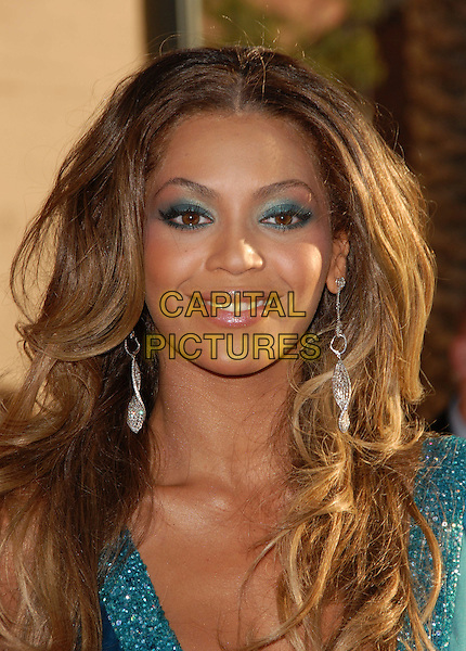BEYONCE KNOWLES.The 34th Annual American Music Awards held at The Shrine Auditorium in Los Angeles, California, USA. - Arrivals.November 21st, 2006.headshot portrait earrings blue eyeliner eyeshadow make-up make up.CAP/DVS.©Debbie VanStory/Capital Pictures