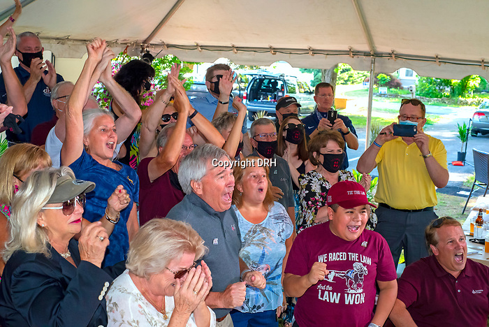 """June 20, 2020: Principal owners of Sackatoga Stables, Jack Knowlton and Ed Mitzen celebrate with other partners and friends  as Tiz the Law won the 152nd Belmont Stakes.  """"Tiz"""" is the first New York bred since 1882 to win the event.  The """"watch party was at Pennell's fine eatery in Saratoga Springs, New York.  Heary/Eclipse Sportswire/CSM"""