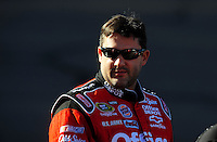 Apr 17, 2009; Avondale, AZ, USA; NASCAR Sprint Cup Series driver Tony Stewart during qualifying for the Subway Fresh Fit 500 at Phoenix International Raceway. Mandatory Credit: Mark J. Rebilas-