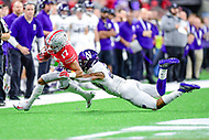 Indianapolis, IN - DEC 1, 2018: Ohio State Buckeyes wide receiver Kamryn Babb (17) is tackled by Northwestern Wildcats linebacker Chris Bergin (28) during second half action of the Big Ten Championship game between Northwestern and Ohio State at Lucas Oil Stadium in Indianapolis, IN. Ohio State defeated Northwestern 45-24. (Photo by Phillip Peters/Media Images International)