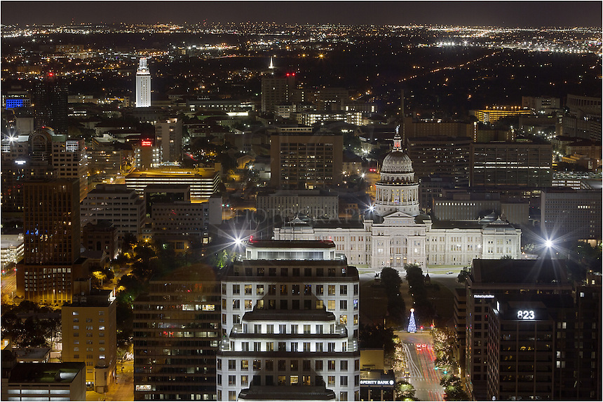 From a high rise condo in downtown Austin, Texas, I captured this photograph of the state capitol with the UT Tower in the distance using a 200mm lens.
