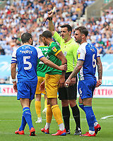 Preston North End's Lukas Nmecha is shown a yellow card by Referee Andrew Madley<br /> <br /> Photographer David Shipman/CameraSport<br /> <br /> The EFL Sky Bet Championship - Wigan Athletic v Preston North End - Monday 22nd April 2019 - DW Stadium - Wigan<br /> <br /> World Copyright © 2019 CameraSport. All rights reserved. 43 Linden Ave. Countesthorpe. Leicester. England. LE8 5PG - Tel: +44 (0) 116 277 4147 - admin@camerasport.com - www.camerasport.com