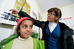 Nurse Ihsan Hamoud weighs a Syrian refugee child in a clinic in Kamd El Loz, in Lebanon's Bekaa Valley. Run by the Amel Association, the clinic's work with refugees is supported by International Orthodox Christian Charities, a member of the ACT Alliance..