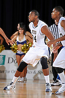 12 January 2012:  FIU center Joey De La Rosa (34) defends in the second half as the Middle Tennessee State University Blue Raiders defeated the FIU Golden Panthers, 70-59, at the U.S. Century Bank Arena in Miami, Florida.