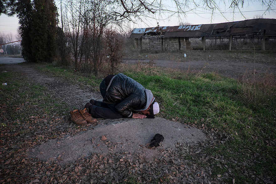 An Afghan migrant prays at at a camp at an abandoned brick factory outside the Serbian border town of Subotica, across from Hungary and the entrance to the European Union. Dozens of migrants try to cross the border from Serbia to Hungary each day on their route to Germany and other Western European countries.