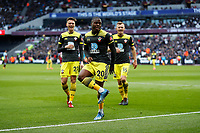 29th February 2020; London Stadium, London, England; English Premier League Football, West Ham United versus Southampton; Michael Obafemi of Southampton celebrates towards the West Ham United fans with Will Smallbone and James Ward-Prowse of Southampton after scoring his sides 1st goal in the 31st minute to make it 1-1