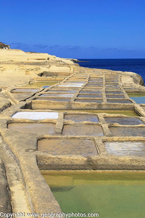 Historic ancient salt pans on coast near Marsalforn, island of Gozo, Malta