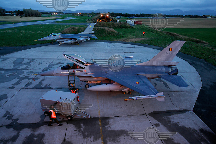 Lockheed Martin F-16 Fighting Falcon Lockheed Martin F-16 Fighting Falcon from Belgian Air Force 349 squadron being inspected after flight. BOLD AVENGER 2007 (BAR 07), a NATO  air exercise at Ørland Main Air Station, Norway. BAR 07 involved air forces from 13 NATO member nations: Belgium, Canada, the Czech Republic, France, Germany, Greece, Norway, Poland, Romania, Spain, Turkey, the United Kingdom and the United States of America. The exercise was designed to provide training for units in tactical air operations, involving over 100 aircraft, including combat, tanker and airborne early warning aircraft and about 1,450 personnel.
