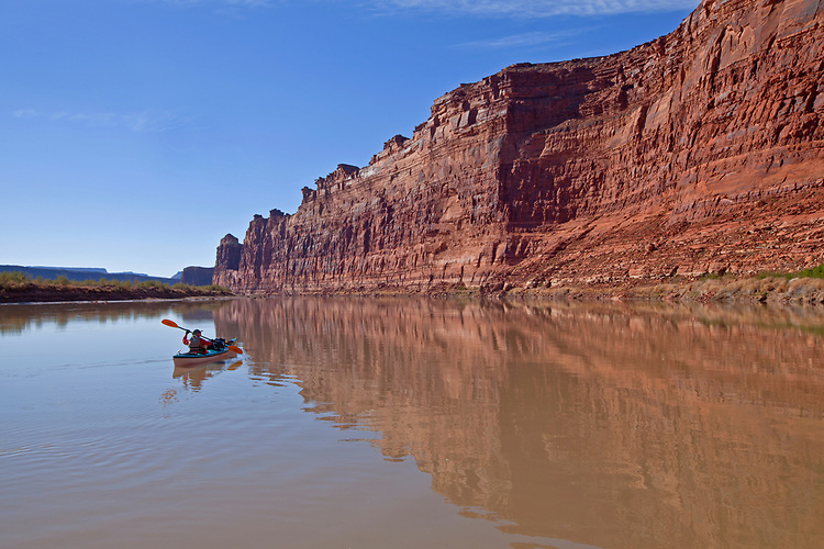 Jacque Miniuk paddles along the Colorado River/Lake Powell just north of the deserted Hite Marina in the Glen Canyon National Recreation Area, Utah